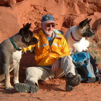 John hiking near Moab with his Akitas.||||