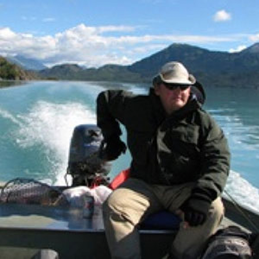 Guy bearing down on salmon in Kenai River.